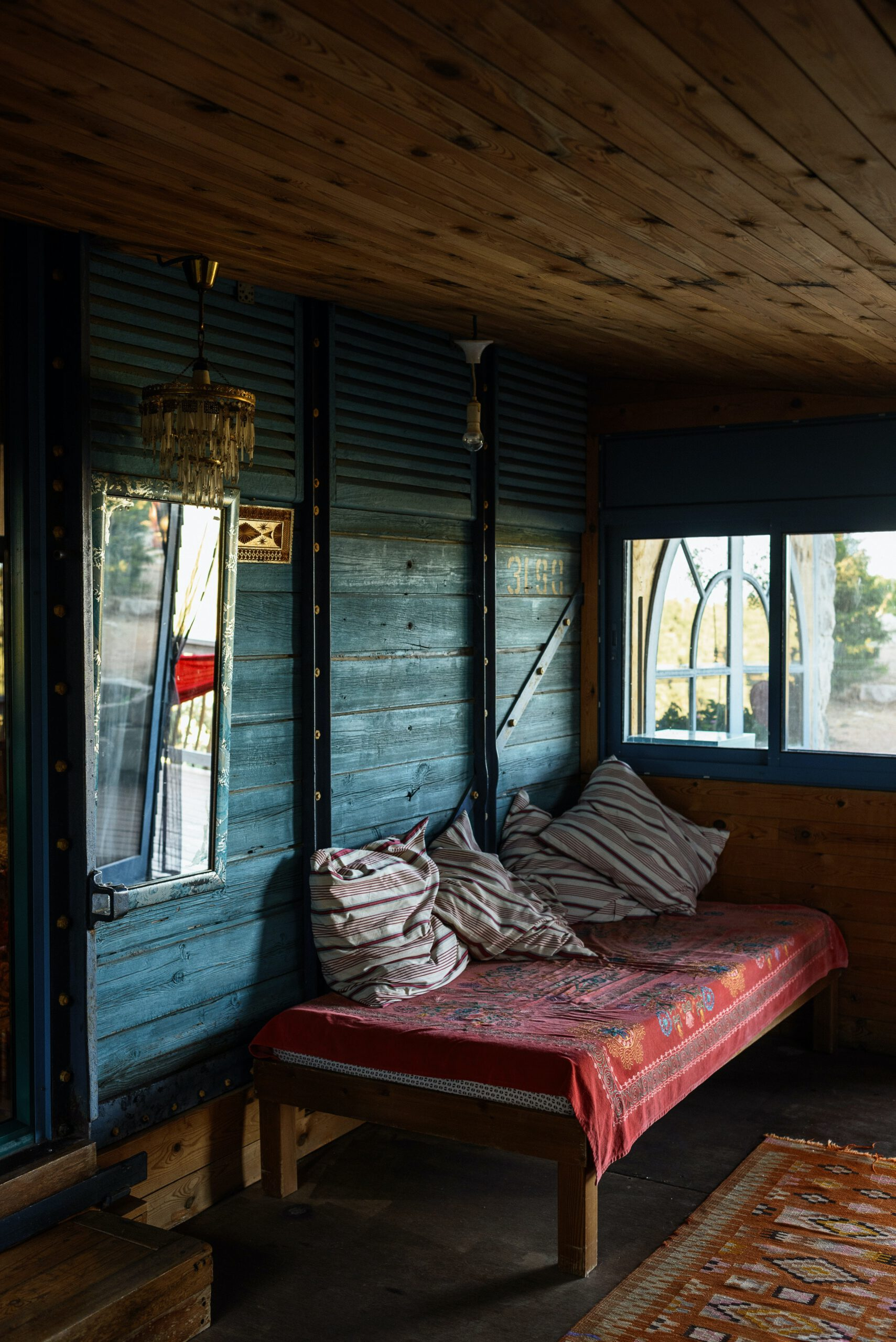 daybed-on-terrace-of-old-shabby-house-3951743